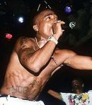 220px-Tupac_Shakur_(rapper),_performing_live